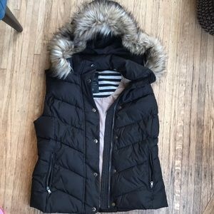 Puffer vest with faux fur hood